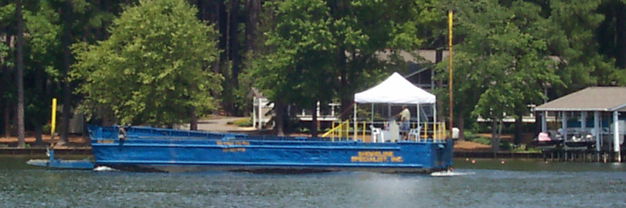 Shoreline Specialists Landing Craft Boat - Controlling Soil Erosion on Lake Gaston